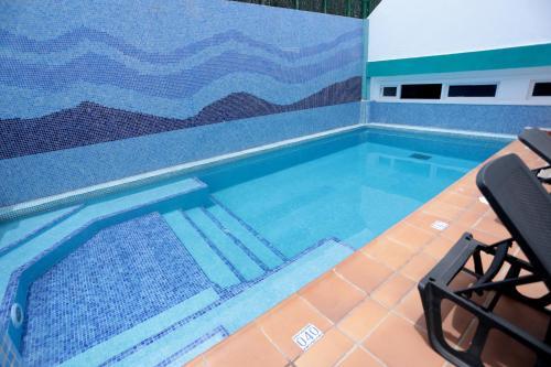 The swimming pool at or near La Casita di Fuerte