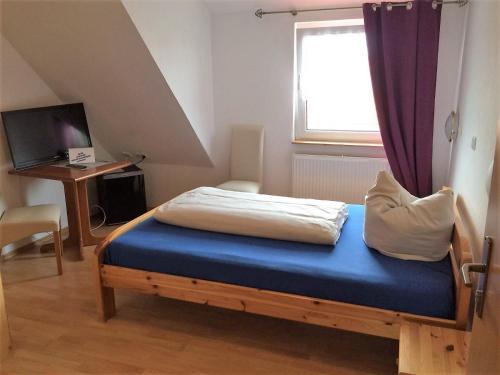 Ein Bett oder Betten in einem Zimmer der Unterkunft Hotel-Restaurant Cafe Caro