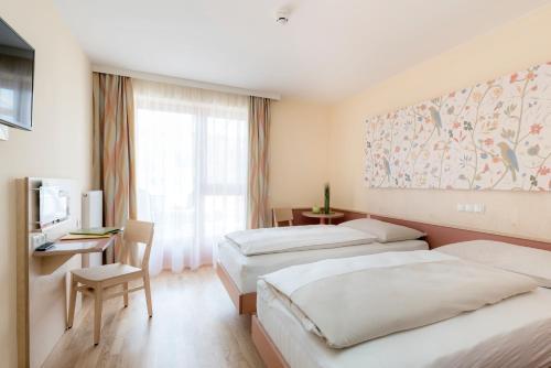 Ein Zimmer in der Unterkunft JUFA Hotel Stubenbergsee