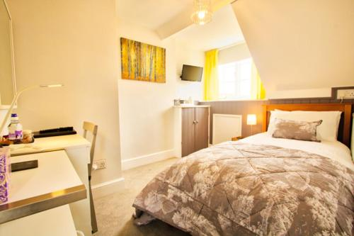 A bed or beds in a room at The Palmerston Rooms
