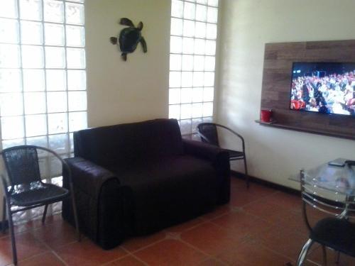 A seating area at Apartamento Piccola Marina