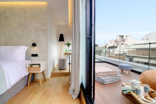 A bed or beds in a room at Coco-Mat Hotel Athens