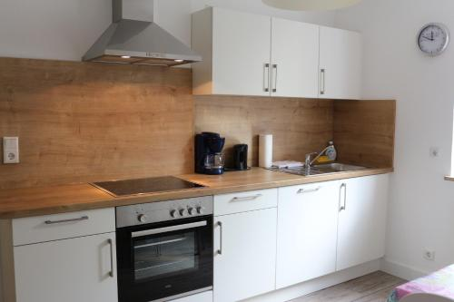A kitchen or kitchenette at Travel Apartments