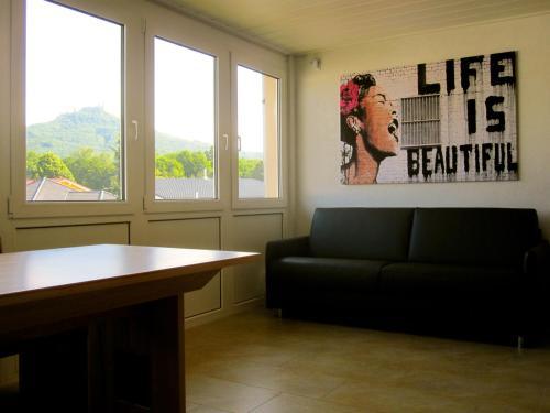 Ein Sitzbereich in der Unterkunft Ferienwohnung Am Ziegelbach