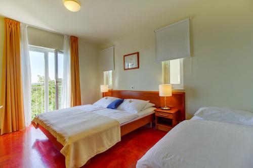 Ein Zimmer in der Unterkunft Family Resort Hotel Manora 4 Stars