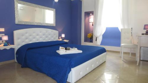 A bed or beds in a room at Antico Casale B&B
