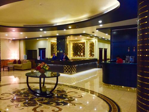 O lounge ou bar de Dar Hashim Hotel Apartments - Al Morouj