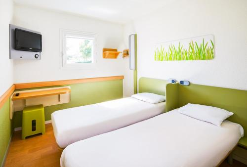 A bed or beds in a room at ibis budget Leicester