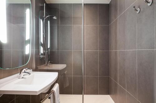 A bathroom at ibis budget London Barking