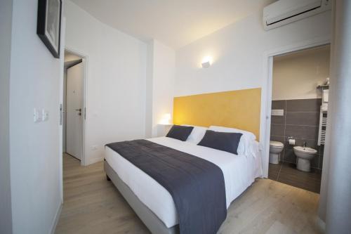 Cama o camas de una habitación en TwoBros Apartment