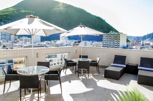 A restaurant or other place to eat at Riale Vilamar Copacabana