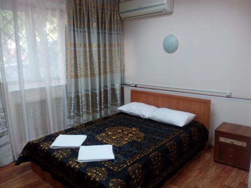 Кровать или кровати в номере Мини-отель Эконом на Маркса