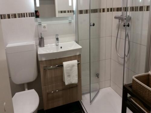 Ein Badezimmer in der Unterkunft Ferienwohnung am Weiher