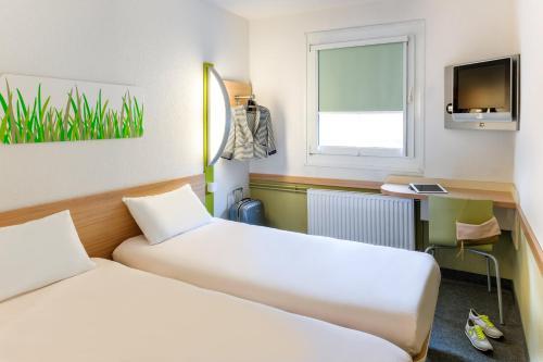 A room at ibis budget Koeln Porz