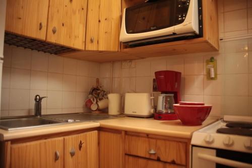 A kitchen or kitchenette at Saint Michel Notre Dame