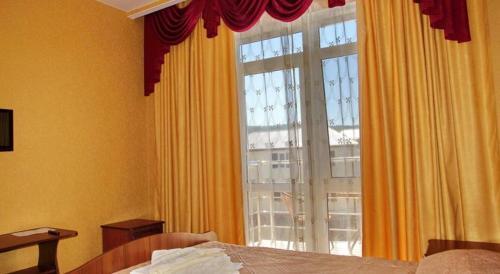 Кровать или кровати в номере Гостевой дом Лимани