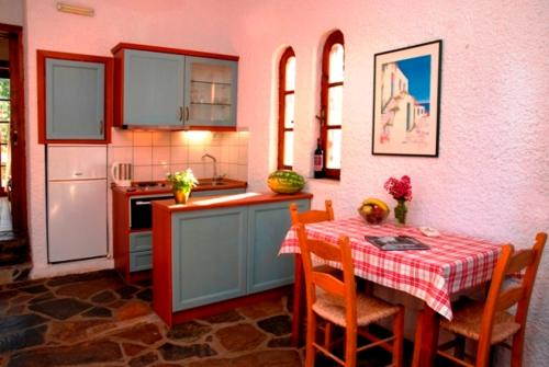 A kitchen or kitchenette at Kalives Apartments