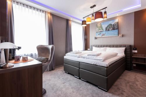 A bed or beds in a room at Stay-Inn Bielefeld City