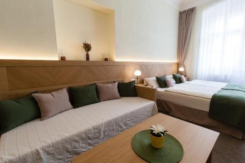 Кровать или кровати в номере Karlova 25 Apartments