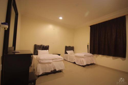 Um quarto em Orkid Arar Residential Units