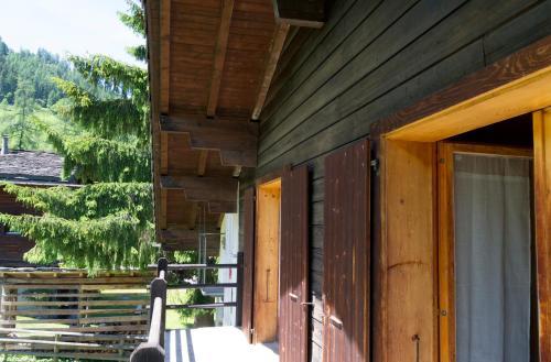 A porch or other outdoor area at à la Maison des Cheneaux