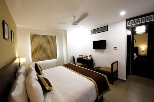 A bed or beds in a room at Hotel Gandharva- A Green Hotel