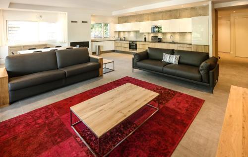 Coin salon dans l'établissement Le Kube Annecy centre Appartements de luxe