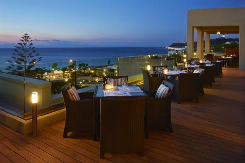 A restaurant or other place to eat at Sheraton Rhodes Resort
