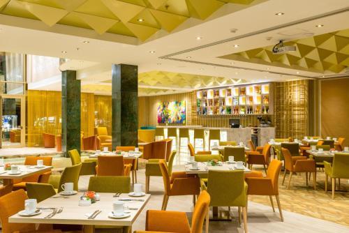 A restaurant or other place to eat at Hotel El Dorado Bogota