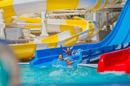 The swimming pool at or near Louis St. Elias Resort & Waterpark