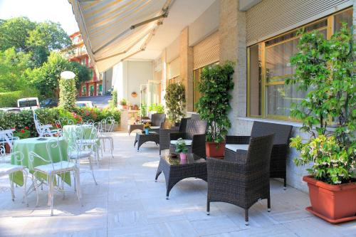 A porch or other outdoor area at Park Hotel