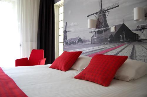 Een bed of bedden in een kamer bij Prinsenhotel