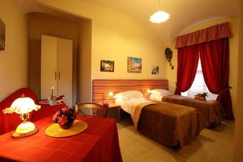 מיטה או מיטות בחדר ב-Bed Breakfast And Cappuccino