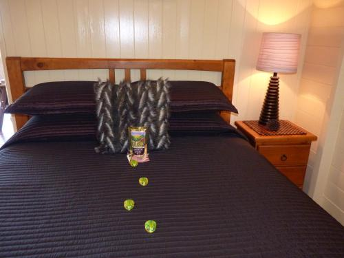 A bed or beds in a room at Barking Owl Retreat - Farm Stay - Exclusive to Adults