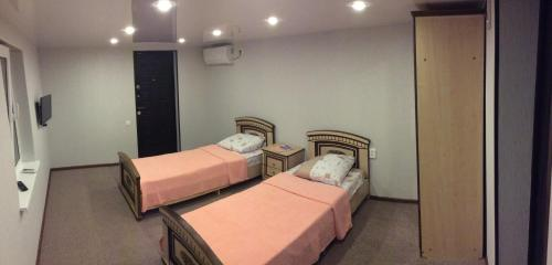 A bed or beds in a room at Guest house Psou