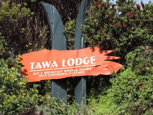 A certificate, award, sign, or other document on display at Waiheke Island Tawa Lodge - Adults Only