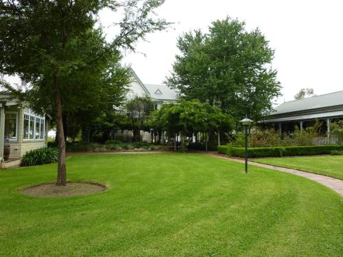 A garden outside The Convent Hunter Valley Hotel