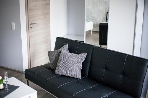 Ein Sitzbereich in der Unterkunft Hoofer Apartments