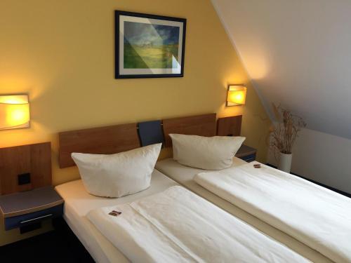 Ein Zimmer in der Unterkunft Hotel Ambiente