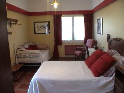 Un ou plusieurs lits dans un hébergement de l'établissement La Corraliere Chambres d'Hôtes