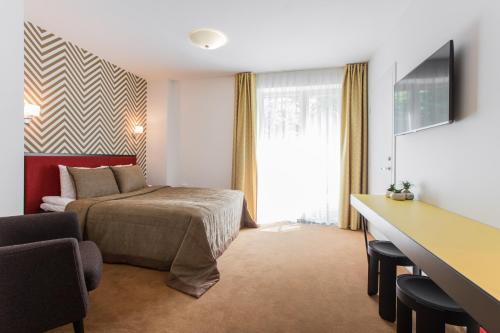 Lova arba lovos apgyvendinimo įstaigoje Viešbutis Simpatija
