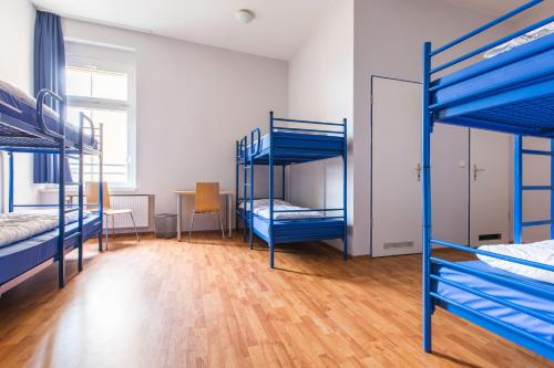 A bunk bed or bunk beds in a room at a&o Dortmund Hauptbahnhof