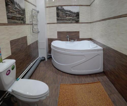 Ванная комната в Gostinitsa Medvedeff Cherdakli