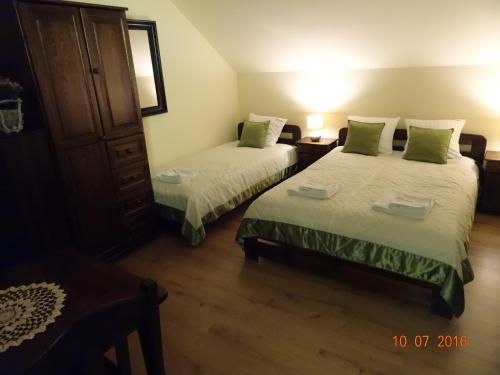 Łóżko lub łóżka w pokoju w obiekcie Willa ZŁOTY OGRÓD