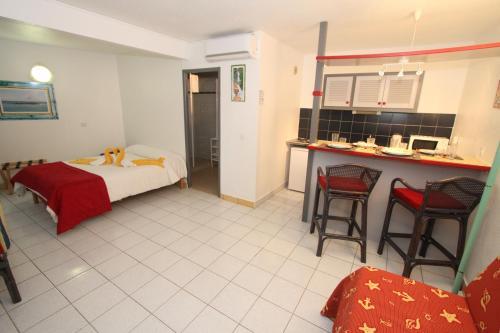 A room at Hotel La Maison Creole