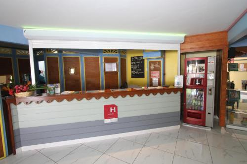 The lobby or reception area at Hotel La Maison Creole