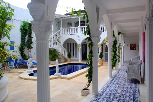 A porch or other outdoor area at Hotel Casa Mara By Akel Hotels