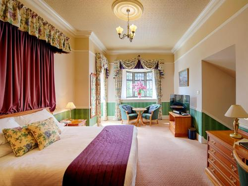 A bed or beds in a room at Kincraig Castle Hotel