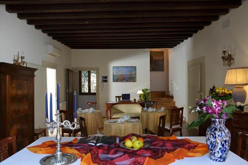 Restaurant ou autre lieu de restauration dans l'établissement B&B Al Palazzetto