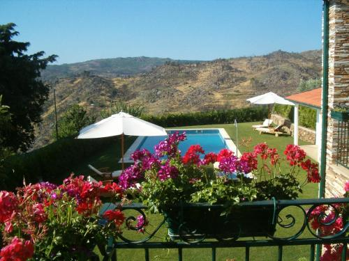 A view of the pool at Quinta Monte Sao Sebastiao or nearby